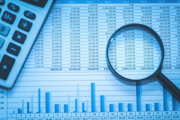 stock image of spreadsheet and magnifying glass